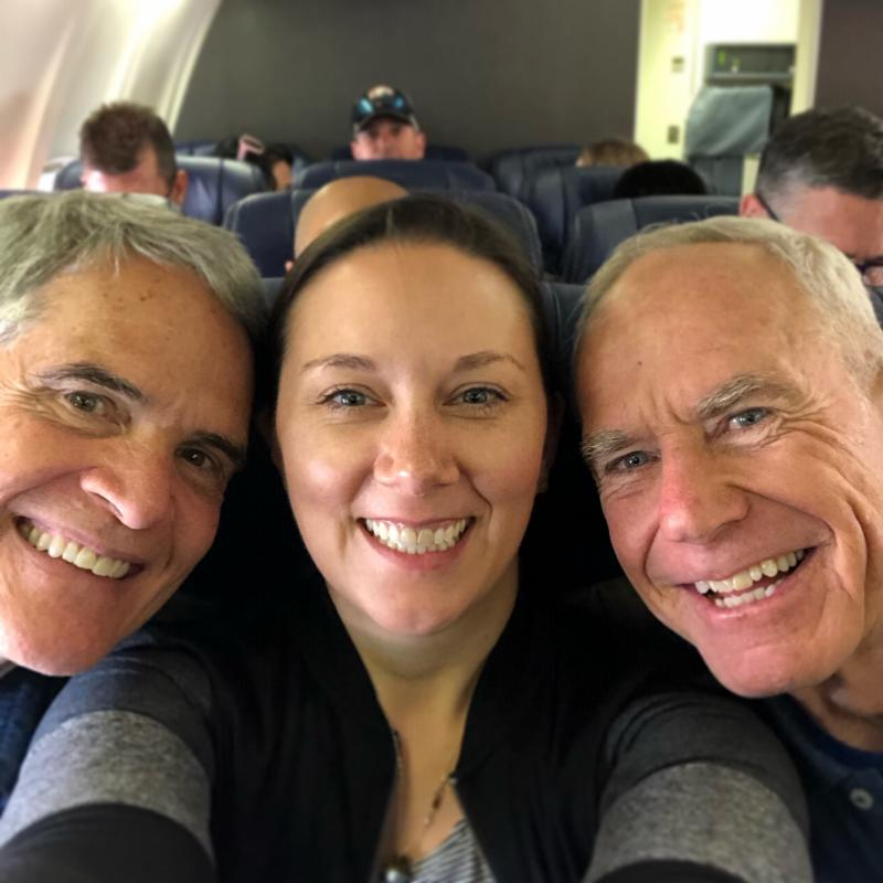 A selfie of Tim, Angie and Michael on a plane.