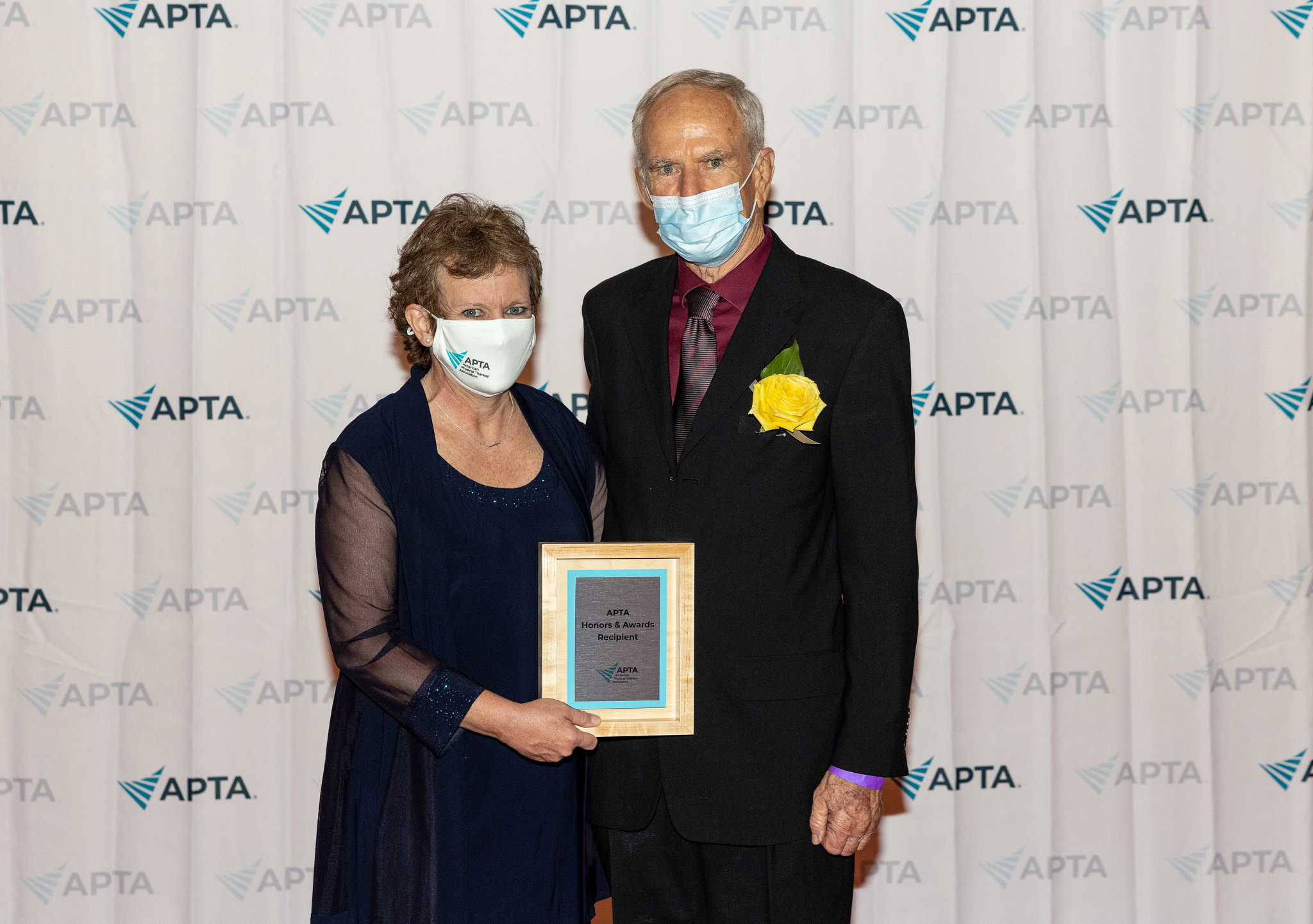 Michael with his award and the APTA president.